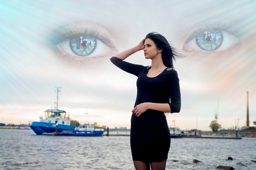 Woman watched by eyes in the sky iStock_000065776195_Small